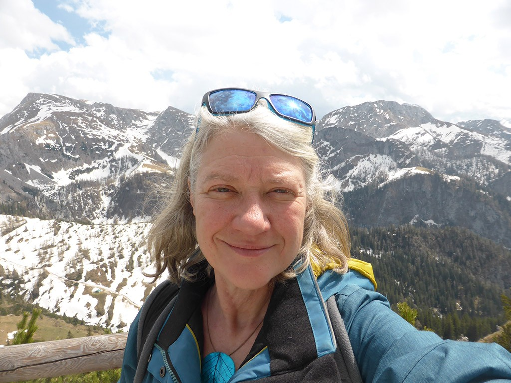 selfie of Clare Brant with mountains in the background
