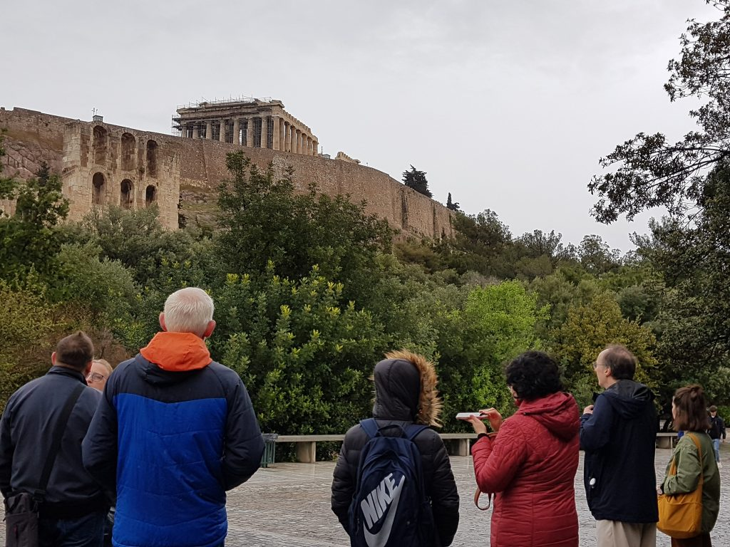 conference delegates lookinug up at the Parthenon